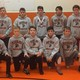 Coach Todd Thompson (left) created and coached this first team of junior high wrestlers this winter. (Todd Thompson)