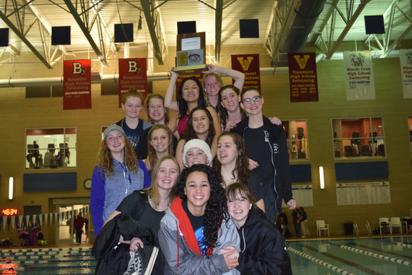 Highland High girls swim team raises the region trophy after taking first place. (Cindy Nordstrom/Highland swim team)