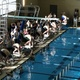 Hunter swimmer Carson Myers (top lane) leans in for the start of Region 2's state qualifier. (Greg James / City Journals)