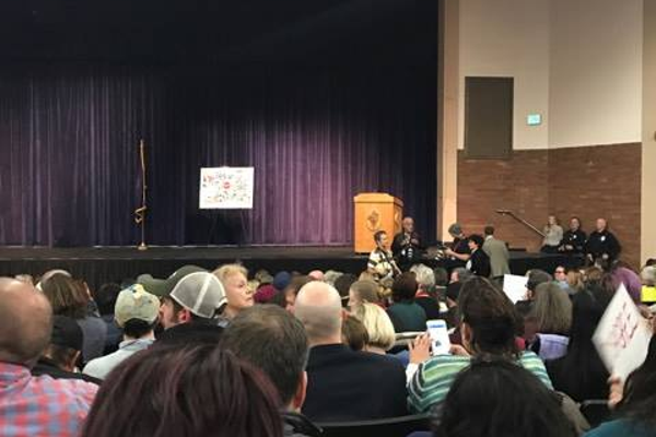 Cottonwood Heights Police Officers and residents wait for Rep. Jason Chaffetz to begin the tTown hHall mMeeting. (Debbie Welder/Cottonwood Heights Citizen)