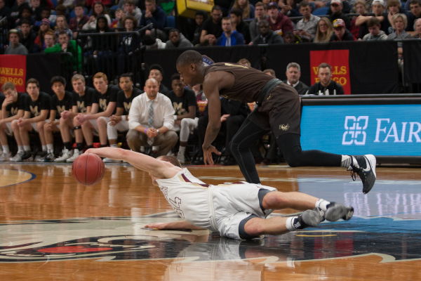 Maple Grove's Brad Davison dove for a loose ball in the first half against Apple Valley.) Photo Courtesy: Imageri By Tim Davis