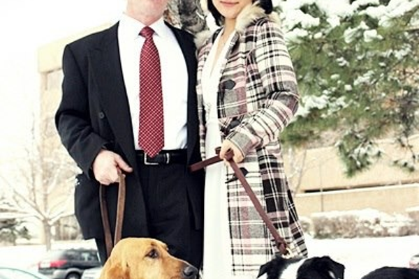 Officer Jon Richey with wife Hannah Yun-Richey, their bloodhound Molly, and border collie Clara. (Hannah Yun-Richey)