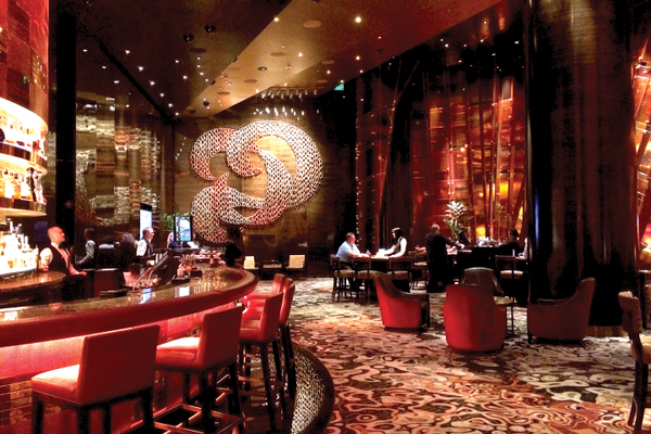 Aria Hotel and Casino custom ceramic wall installation in Las Vegas with 900 ceramic rings hangs on airplane cable.