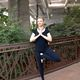 Amanda Jones, certified yoga teacher and meditation coach, performs tTree pPose amid South American plants and trees. (Keyra Kristoffersen/City Journals)