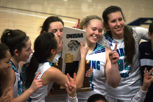 Anna Ewoniuk kisses the 3A state championship trophy. (Juan Diego girls basketball)
