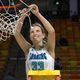 Senior Brynn Drummond cuts down the net after the Soaring Eagles' state championship victory. (Juan Diego girls basketball)