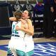 Anna Ewoniuk hugs one of her best friends, Becca Curran, after winning the 3A state championship. (Juan Diego girls basketball)