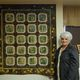 Mary Hutchings stands with one of her favorite finished works detailing aspen trees. (Keyra Kristoffersen/City Journals)