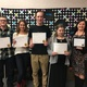 Kyle Christensen, Taylor Dee, Eric Evans, Brandee Hick and their teacher Melinda Mansouri hold up certificates they won in the Verizon Innovative Learning app challenge. (Tori La Rue/City Journals)