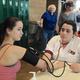 Sarah LeGrande gets her blood pressure checked by a Roseman University nursing student. (Mylinda LeGrande/City Journals)
