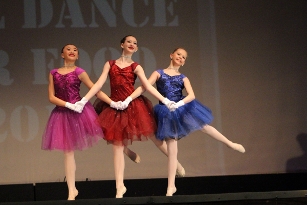 Teen dancers perform their trio routine at the Will Dance for Food Competition at Taylorsville High School on March 3. (Tori La Rue/City Journals)