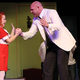 "Elizabeth Birkner, playing the role of Annie, and Todd Young, playing the role of Oliver Warbucks, perform a handshake during the Riverton Art's Council's production of ""Annie."" (Tori La Rue/City Journals)"