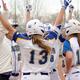 The Bruins women's softball team celebrates victory over USU Eastern in its home series March 11. (Rachel Rowan/SLCC athletics)
