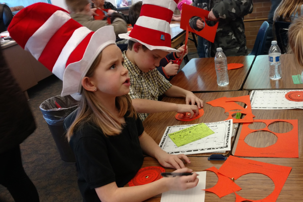 First-graders Ember Goode and Keenan Klaus participate in literacy activities. (Jet Burnham/City Journals)