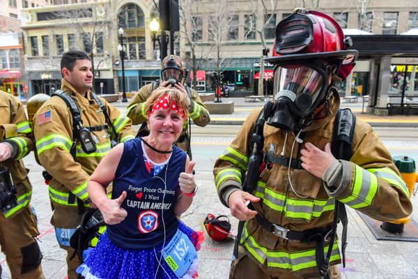 Wendy Weixler poses with firemen as they raise money for cancer. (Wendy Weixler)