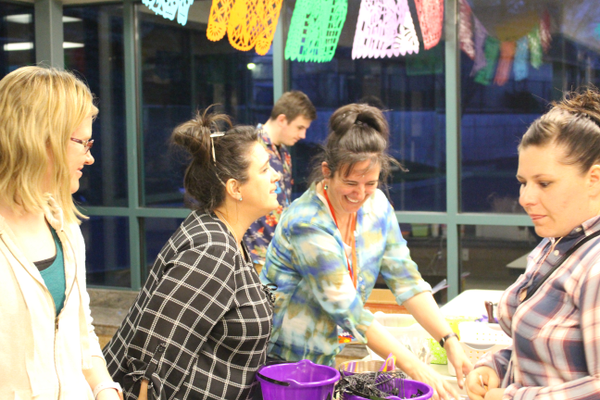 Volunteers laugh during Highland Park Arts Night. (Travis Barton/City Journals)