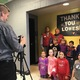 Some of the kids had fun with photo ops in front of their new bathroom with the Lowes team. (Natalie Mollinet\City Journals).