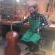 """John """"JP"""" Lucas has been building violins since he was 13. (Natalie Mollinet/City Journals). Cellist 03: Some of the instruments Lucas is working on going off to musicians around the world. (Natalie Mollinet\City Journals)."""