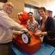 Sesame Streets® Elmo lends a hand as PNC Military Employee Business Resource Group assemble trikes and wagons