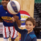 After receiving an award for caring about his fellow students, Quail Hollow third-grader Qwade Rondeau gets tickets to the Harlem Globetrotters pre-show and game where he gets to spins a ball on his finger. (Tausha Rondeau/parent)