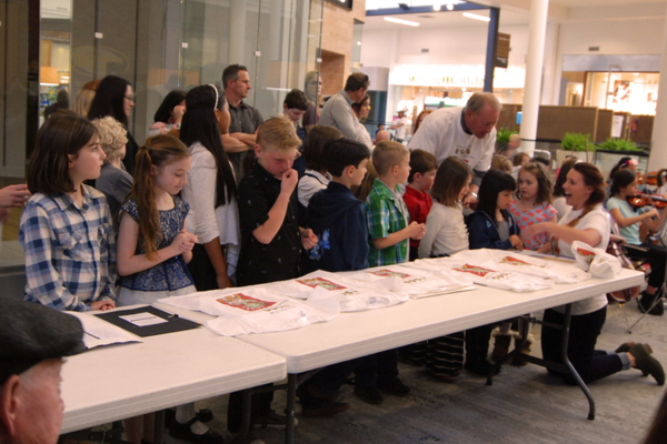 The winners of the art show are gathered by grade and class before being presented to the audience and receiving their awards. (Keyra Kristoffersen/City Journals)