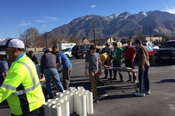 Citizen volunteers work with staff to construct sandbag filling stations. (Mike Halligan/ Cottonwood Heights City)