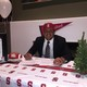 Sione Lund poses for a photo on national signing day decked in Stanford gear and surrounded by Stanford paraphernalia. (Sione Lund/Facebook)