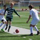 Senior Abe Gubler takes on a Murray defender in April. (Travis Barton/City Journals)