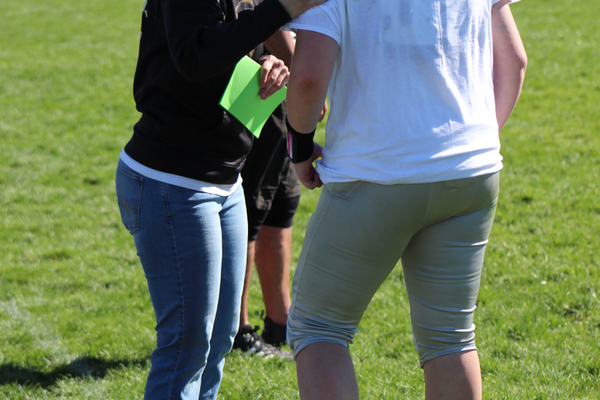 Head coach Barbara Calchera speaks with her player during the Angels opening game. The team plays every Saturday through May at Westmore Elementary in West Jordan. (Travis Barton/City Journals)