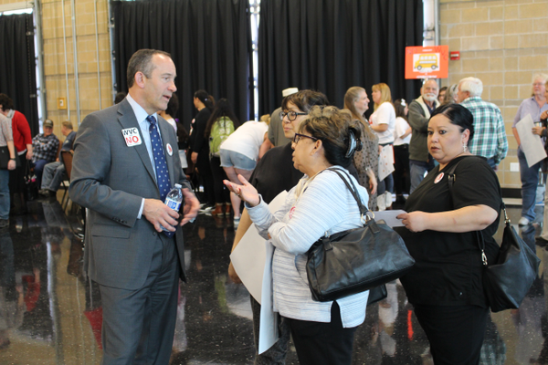 City Manager Wayne Pyle speaks with residents at a site selection open house. (Travis Barton/City Journals)
