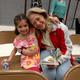 : Camille Robinson reads to her granddaughter Arley Bezanson. (Jet Burnham/City Journals)