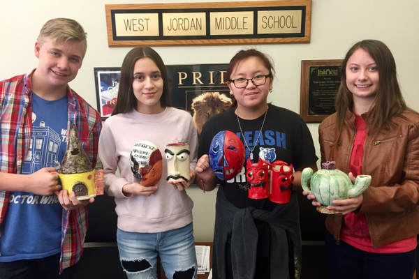 Students Zachary Both, Diana Rincon, Victoria Nguyen and Brianna Lucas pose with their pieces selected for a national ceramics competition. (Ellice Taylor/West Jordan Middle)
