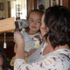 Tattianna Martin shows her daughter Olivia an antique stereoscope card viewer. (Carl Fauver/City Journals)