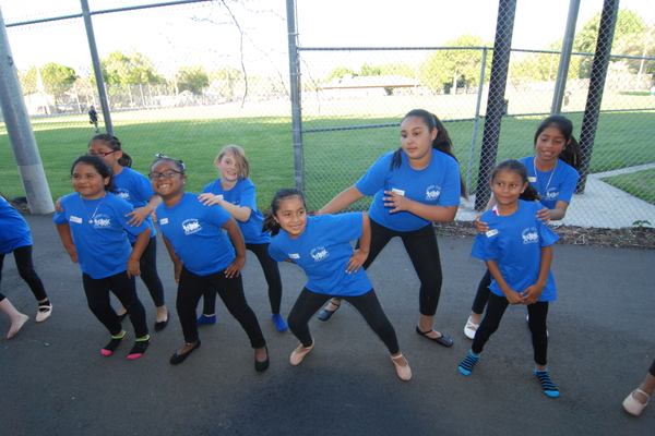 Sandy Club kids practicing their dance routine before going onstage at the gala. (Keyra Kristoffersen/City Journals)