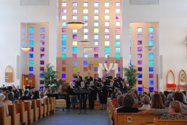 The choir from the St. Thomas More Catholic Church start off the Interfaith Music Festival. (Keyra Kristoffersen/City Journals)