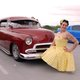 Brandy Anderson poses next to a classic car on display. (Keyra Kristoffersen/City Journals)