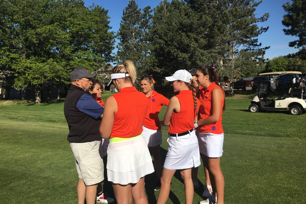 Brighton girls varsity golf team huddles with coach before the state tournament. (Clark Garso/ Brighton High School)