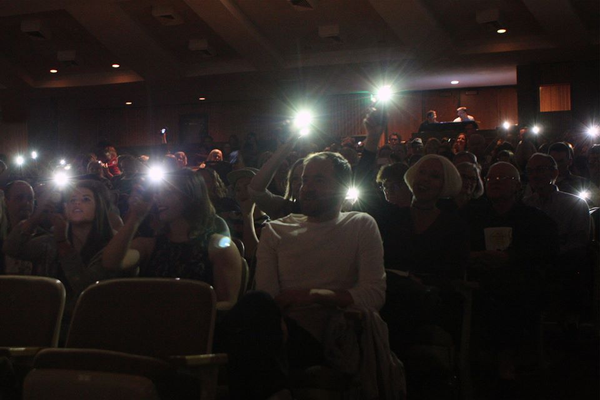 Audience members shine their phone lights during the BeatALS benefit concert at Cottonwood High School on May 1. (Richard Caldwell/Beat ALS Benefit Facebook)