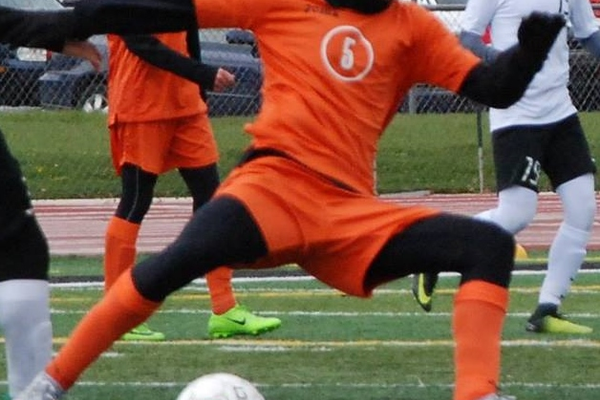 Tanner Erekson nearly does the splits controlling the ball. (Murray Soccer Facebook)