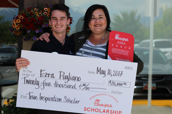Ezra Pugliano, a Chick-fil-A employee, and his boss Becky Pickle, owner of the South Jordan Chick-fil-A, pose for a picture with the giant $25,000 scholarship Chick-fil-A corporate members presented to Pugliano on May 10. (Tori La Rue/City Journals)