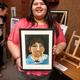 West Jordan high school senior Abril Susunaga shows off the portrait she made of a Bolivian child. (Jet Burnham/City Journals)