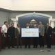 Rocky Mountain Power representatives present the West Jordan's city council with a $240,298.50 rebate check. (Tori La Rue/City Journals)