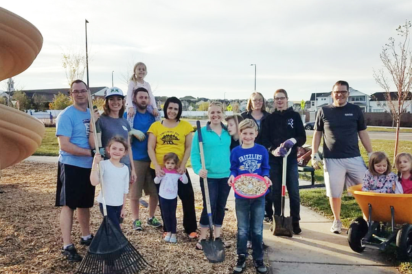 Residents near the Oaks East Park organized their own group effort to spread wood chips on the Monday night following I Love West Jordan Day. (Mandy Clifford)
