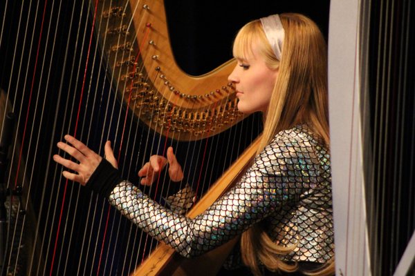 "Kennerly Witt plays ""Sweet Child O' Mine"" by Guns N' Roses on a grand concert harp. The duo arrange all their songs themselves. (Travis Barton/City Journals)"