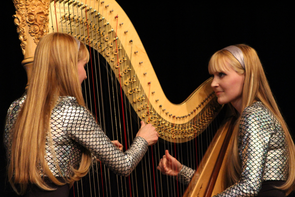 "The Harp Twins, Camille and Kennerly Witt, play ""One"" by Metallica on a grand concert harp. (Travis Barton/City Journals)"