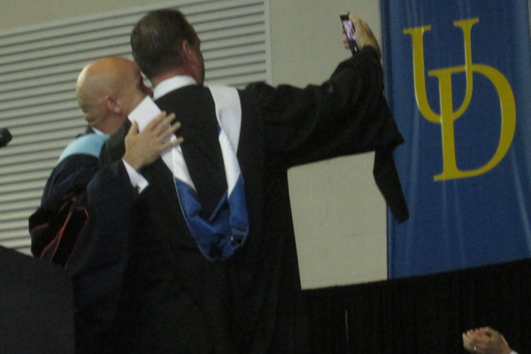 James Conley and district superintendent John Sanville take a selfie.