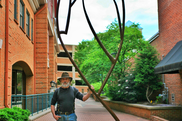 Sigafoos with 'Kennett Squared,' recently installed on the Genesis Walkway in Kennett Square. (Photo by Adrian Gibbs)