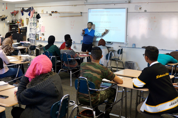Yuri Perez leads a classroom discussion on geometric sequence. (Aspen Perry/City Journals)
