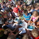 Crowds of children help the butterflies on their way at the Ladybug Festival (Keyra Kristoffersen/City Journals)