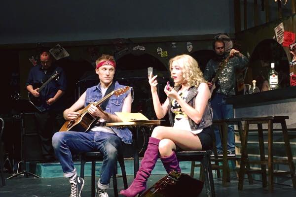 "Jake Holt and Cassidy Ross play love interests Drew and Sherry in Midvale Theatre's latest show, ""Rock of Ages."" (Midvale Main Street Theatre)"
